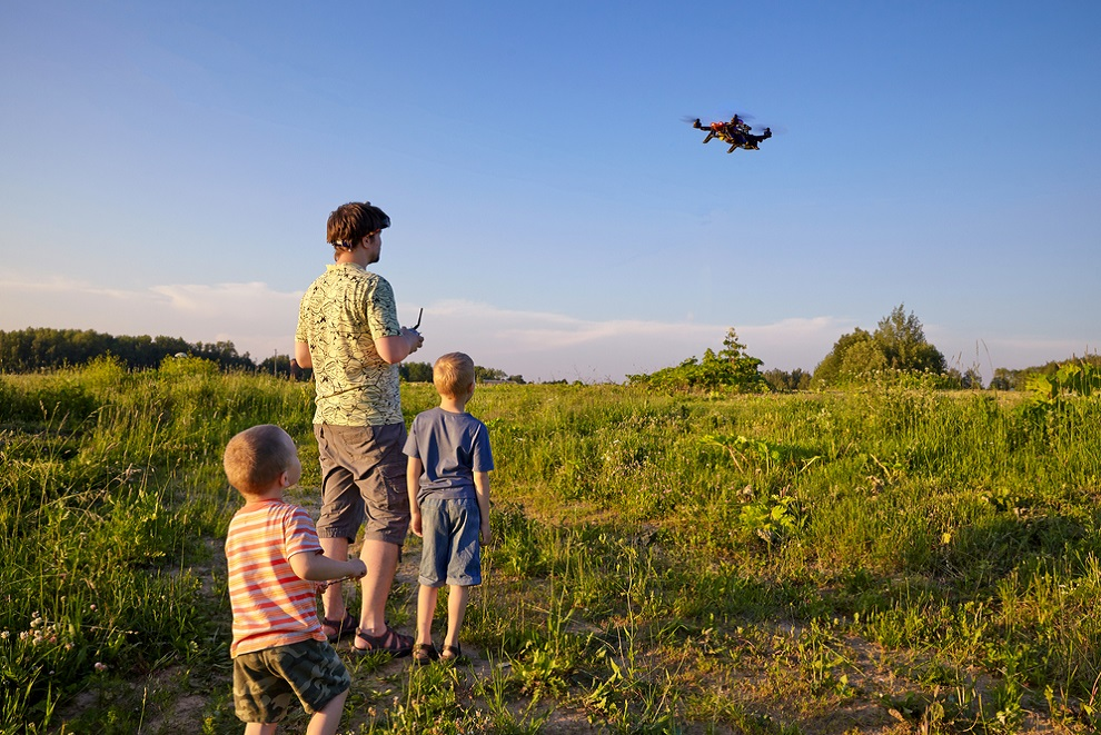 kids are playing with toy drone
